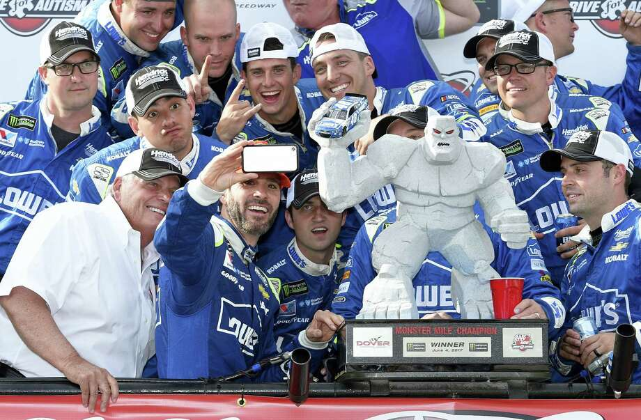Jimmie Johnson,  second from front left, at Victory Lane after winning at Dover International Speedway in Dover, Del. Sunday. Photo: Nick Wass — The Associated Press  / FR67404 AP