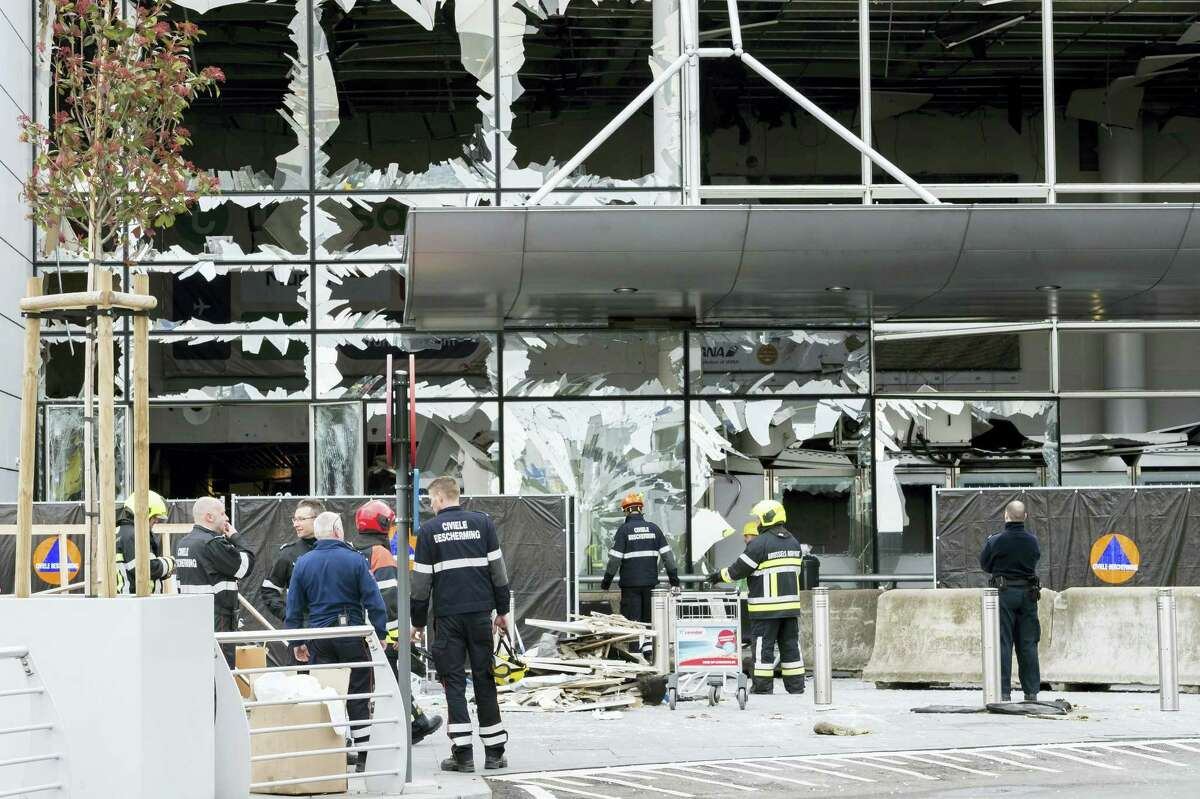 In this March 23, 2016 photo, police and other emergency workers stand in front of the damaged Zaventem Airport terminal in Brussels. The deadly vehicle and knife attack June 3, 2017 on London Bridge and in nearby Borough Market is the latest attack in Europe in recent years. On March 22, 2016, suicide attacks on the Brussels airport and subway kill 32 and injure hundreds. The perpetrators have been closely linked to the group that carried out earlier attacks in Paris.