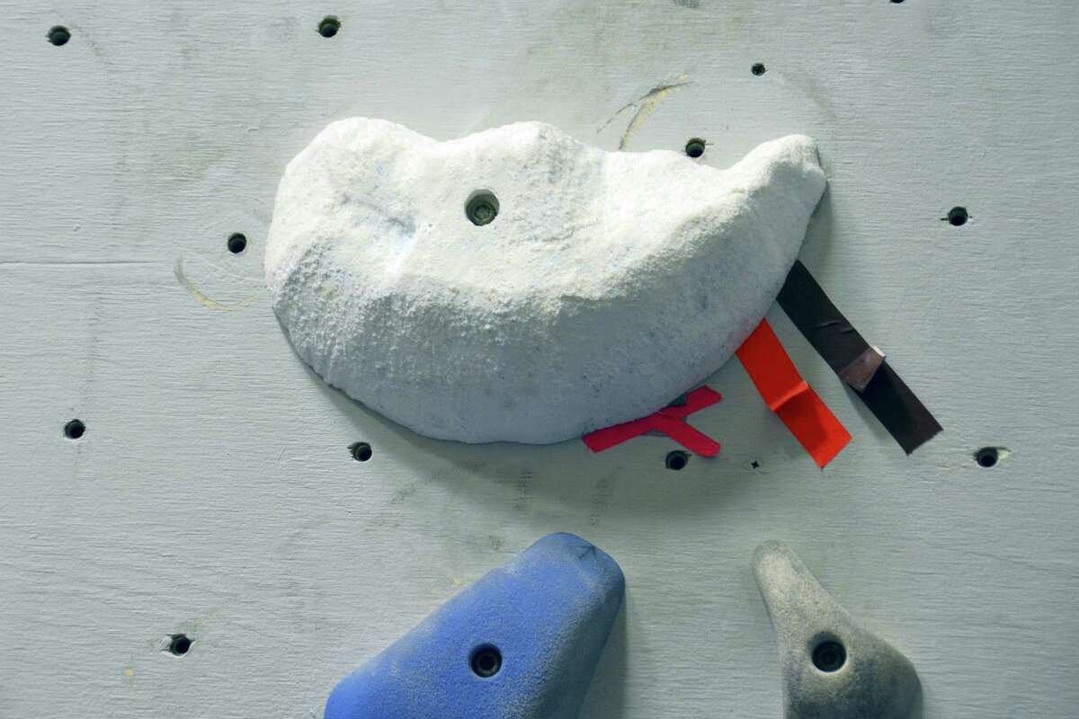 This Jan. 16, 2016 photo provided by Dartmouth College shows fabricated holds mounted on a climbing wall in Hanover, N.H. The hold, created by using three-dimensional geometry, is part of a replica of a rock wall created by tracking a climber's hand and foot positions and by estimating the contact forces.