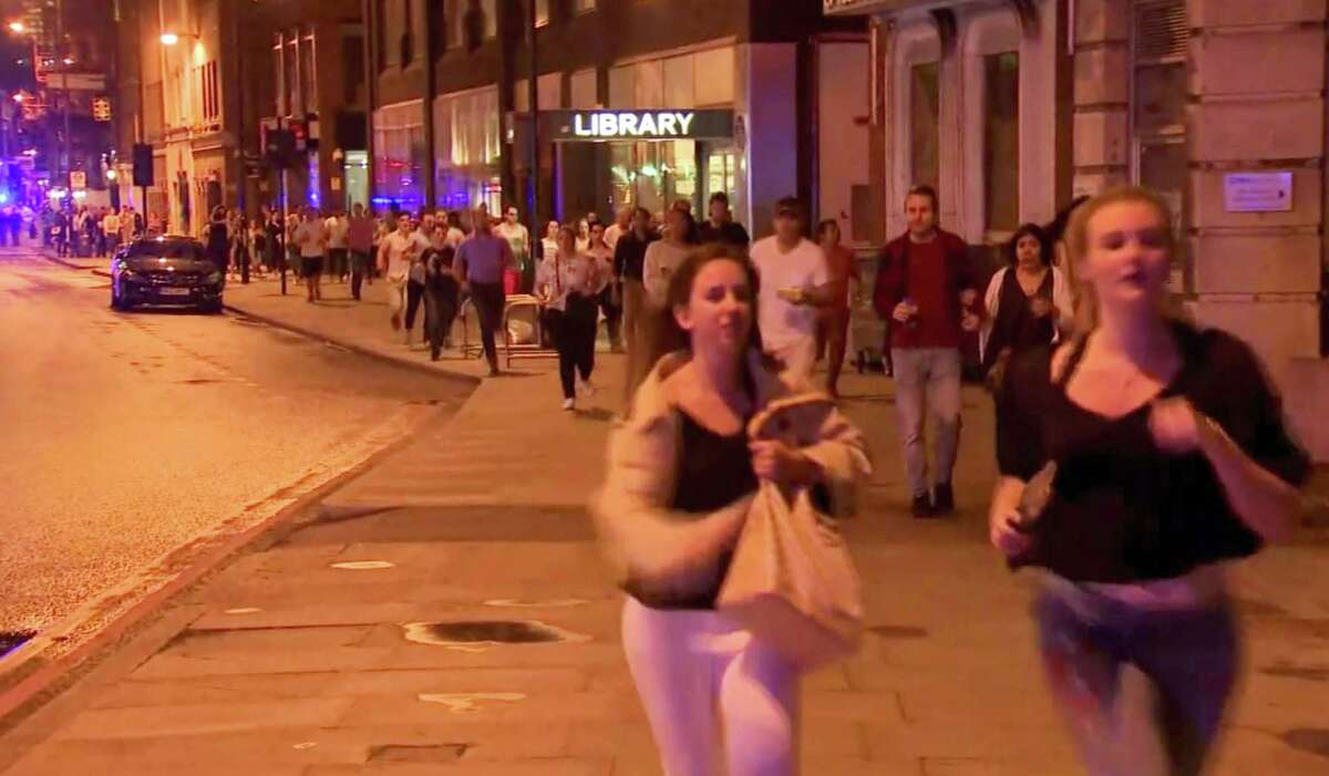 In this Saturday, June 3, 2017, image made from a video, people run from the scene an attack in London. Chaos broke out for several minutes during Saturday night's attack in the heart of the city, with people scattering in all directions, sometimes directly into the path of the men trying to kill them. (Sky news via AP)