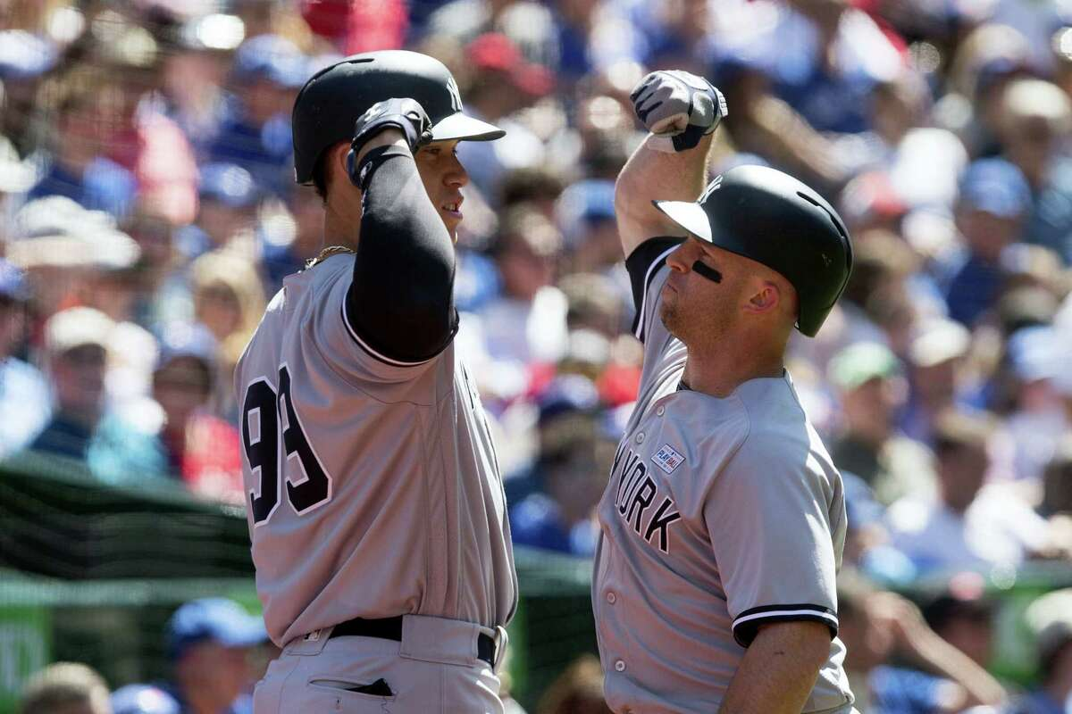 New York Yankees' Brett Gardner, right, celebrates with teammate Aaron Judge after hitting a solo home run off Toronto Blue Jays relief pitcher Jason Grilli during the eighth inning of a baseball game in Toronto, Saturday, June 3, 2017. (Chris Young/The Canadian Press via AP)