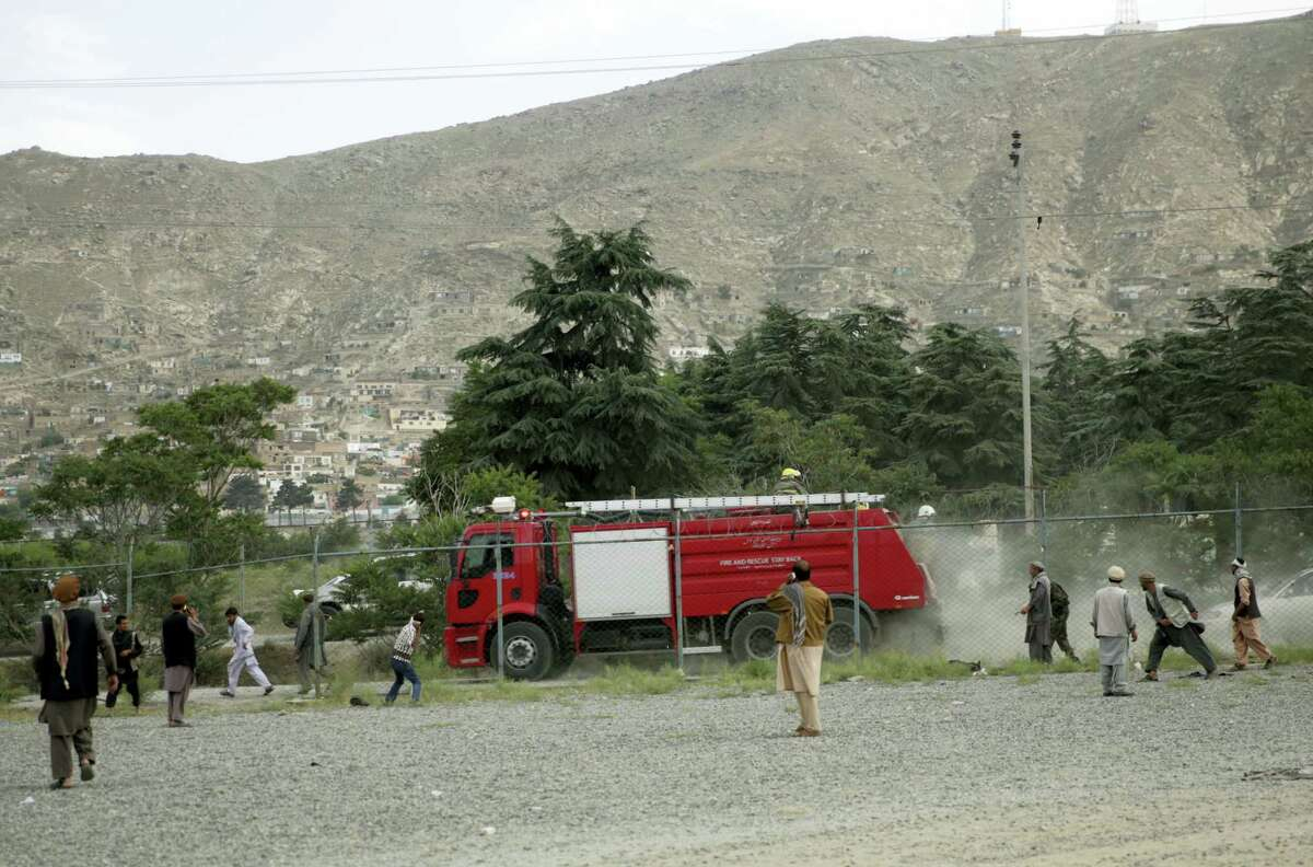 Angry men stone a fire fighter vehicle at the site of three suicide attacks during a funeral ceremony, in Kabul, Afghanistan, Saturday, Jun 3, 2017. Explosions in Kabul on Saturday killed at least six people attending a funeral reportedly attended by government officials, including members of parliament, a day after hundreds of demonstrators turned out to demand more security in the capital.