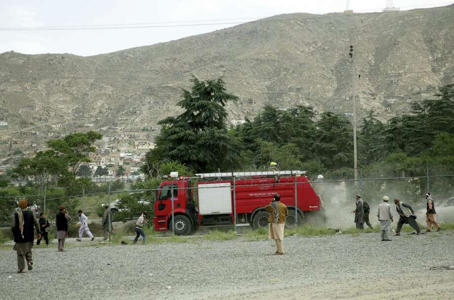 Angry men stone a fire fighter vehicle at the site of three suicide attacks during a funeral ceremony, in Kabul, Afghanistan, Saturday, Jun 3, 2017. Explosions in Kabul on Saturday killed at least six people attending a funeral reportedly attended by government officials, including members of parliament, a day after hundreds of demonstrators turned out to demand more security in the capital. Photo: AP Photos/Massoud Hossaini   / Copyright 2017 The Associated Press. All rights reserved.