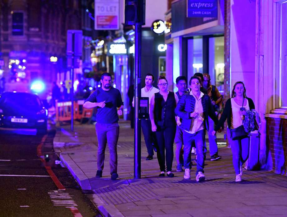 """People run down Borough High Street as police are dealing with a """"major incident"""" at London Bridge in London, Saturday, June 3, 2017. Photo: Dominic Lipinski — PA Via AP  / PA"""