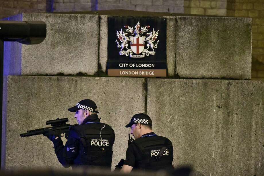 "An armed Police officer looks through his weapon on London Bridge in London, Saturday, June 3, 2017.  British police said they were dealing with ""incidents"" on London Bridge and nearby Borough Market in the heart of the British capital Saturday, as witnesses reported a vehicle veering off the road and hitting several pedestrians. Photo: Dominic Lipinski — PA Via AP  / PA"