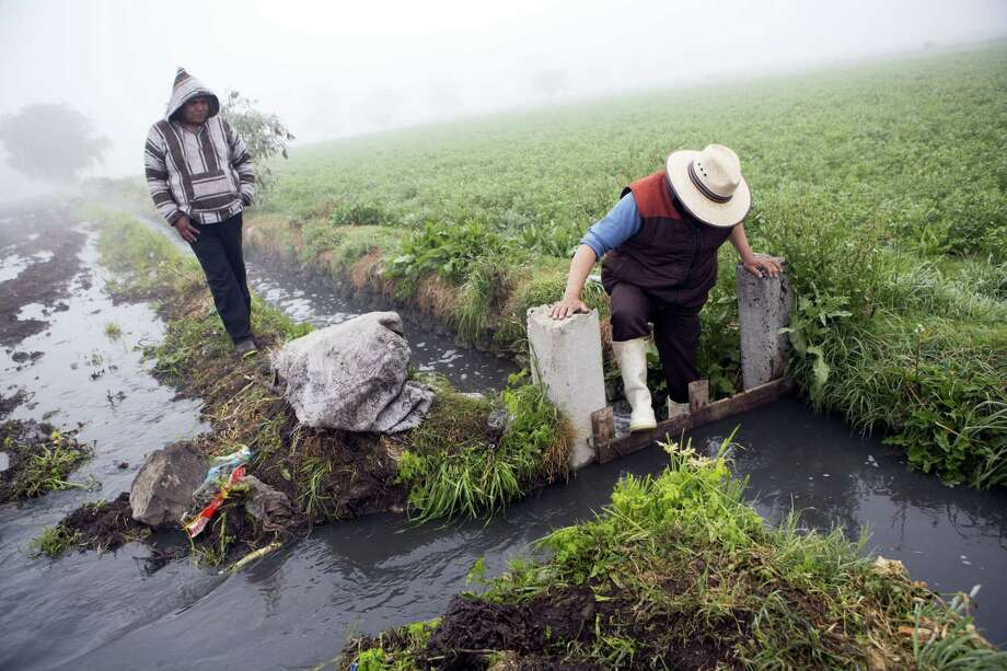 A worker dams off a canal to divert wastewater onto a field where corn will be planted, in Santa Ana Ahuehuepan, north of Tula, Hidalgo state, Mexico. Photo: Rebecca Blackwell — The Associated Press  / Copyright 2017 The Associated Press. All rights reserved.
