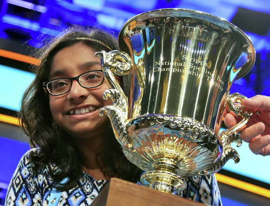 Ananya Vinay, 12, from Fresno, Calif., holds the trophy after being declared the winner of the 90th Scripps National Spelling Bee, in Oxon Hill, Md., Thursday, June 1, 2017. Photo: AP Photo/Manuel Balce Ceneta   / Copyright 2017 The Associated Press. All rights reserved.