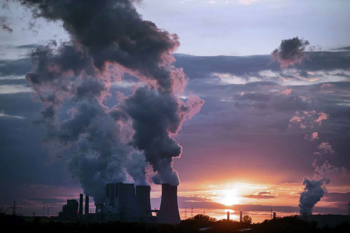 In this April 27, 2017, file photo smoke billows out of the chimneys of the Neurath lignite power plant in Neurath. Germany. World leaders affirmed their commitment Thursday, June 1, 2017, to combating climate change ahead of U.S. President Donald Trump's announcement on whether he would pull out of the Paris climate accord. Trump is expected to announce his decision on Thursday afternoon.