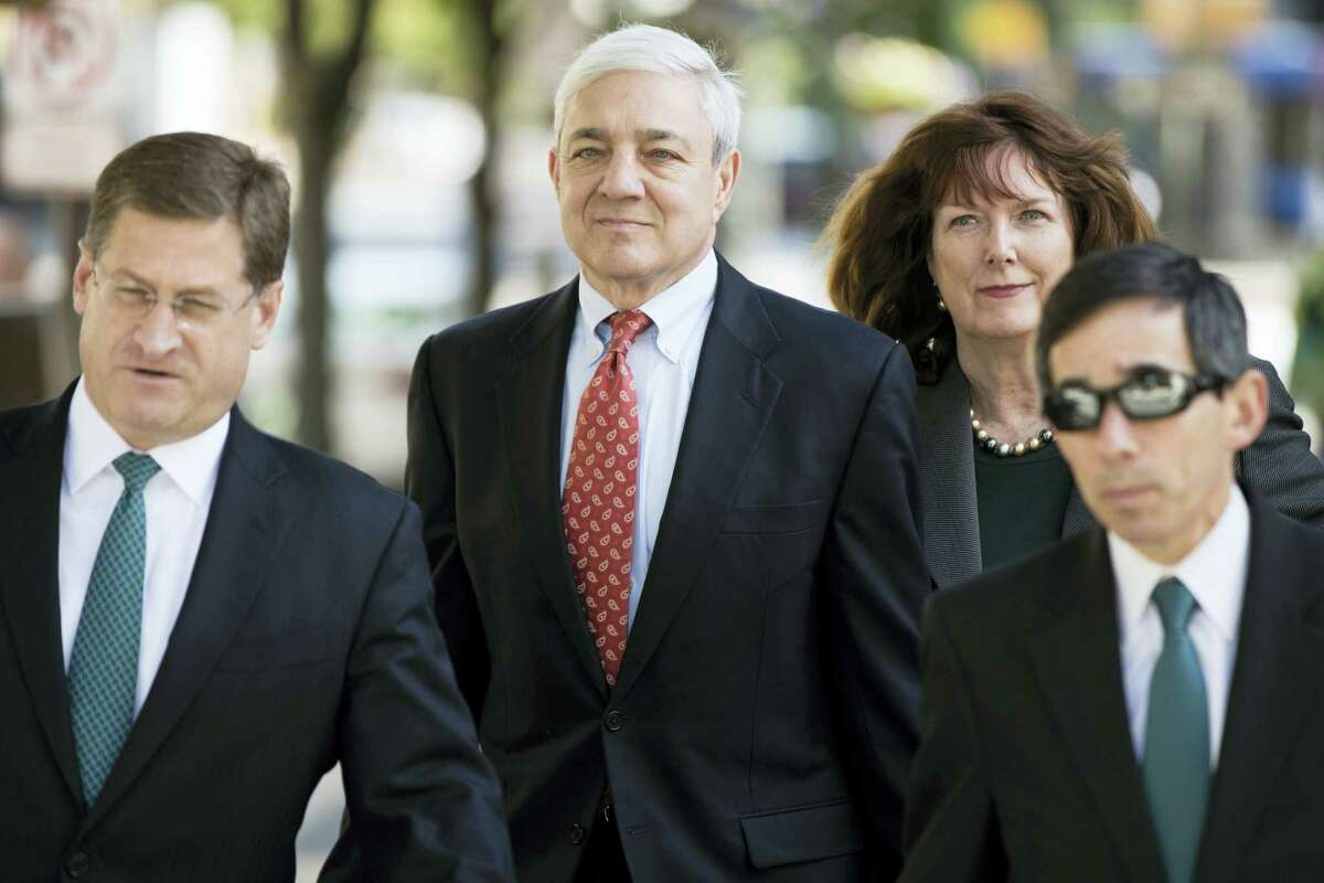 Former Penn State President Graham Spanier, center, arrives for his sentencing hearing at the Dauphin County Courthouse in Harrisburg, Pa., Friday, June 2, 2017.