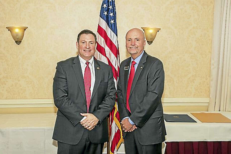 Contributed photoLt. Col. Robert Darling, left, is joined by Paul McLaughlin at the recent 7th Annual Connecticut Mutual Holding Company Business Breakfast in Torrington. Photo: Digital First Media / Steven zarrella