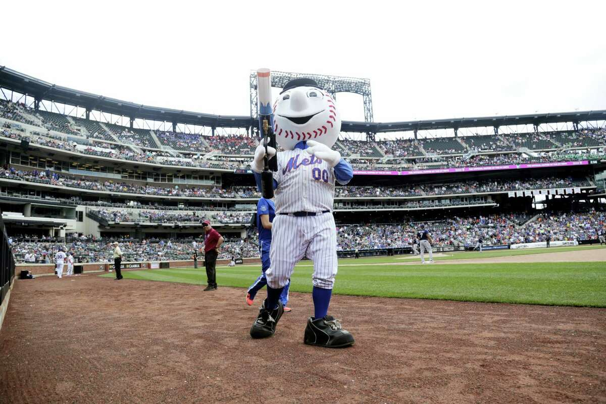 Mr Met distributes t-shirts to fans during the sixth inning Thursday at Citi Field.