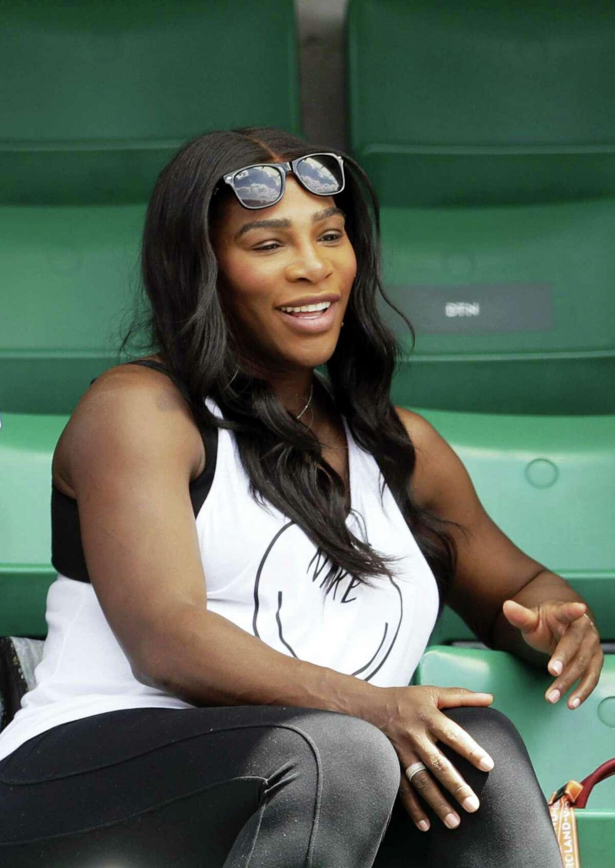 Serena Williams watches her sister Venus Williams play Kurumi Nara at the French Open earlier this week.