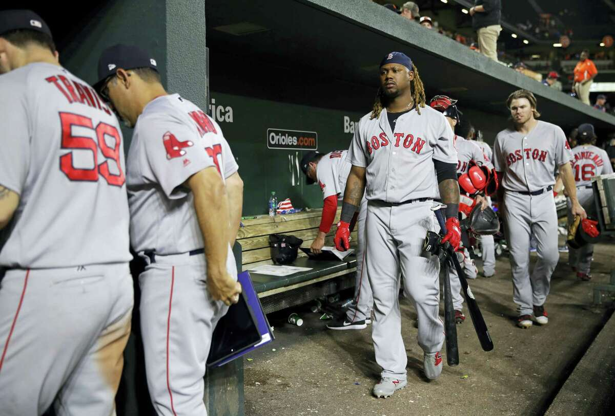 Hanley Ramirez, center, follows teammates out of the dugout after Thursday's loss to the Orioles.