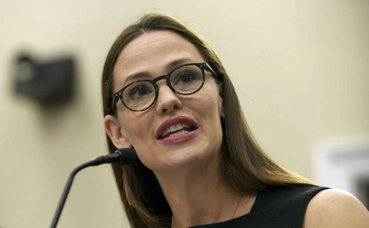In this March 16, 2017, file photo, actress Jennifer Garner, a Trustee for Save the Children, testifies on Capitol Hill in Washington. Garner wrote on Facebook May 31, 2017, that she did not pose for the cover of the current issue of People magazine or 'participate in or authorize' the accompanying article.