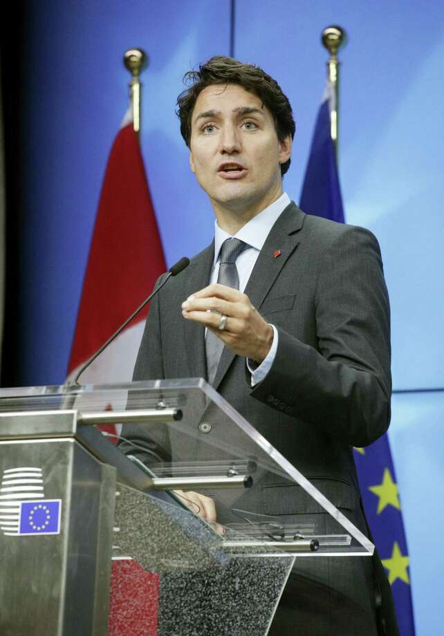 Canadian Prime Minister Justin Trudeau speaks during a media conference at the conclusion of an EU-Canada summit at the European Council building in Brussels. Photo: Olivier Matthys — The Associated Press  / Copyright 2016 The Associated Press. All rights reserved.