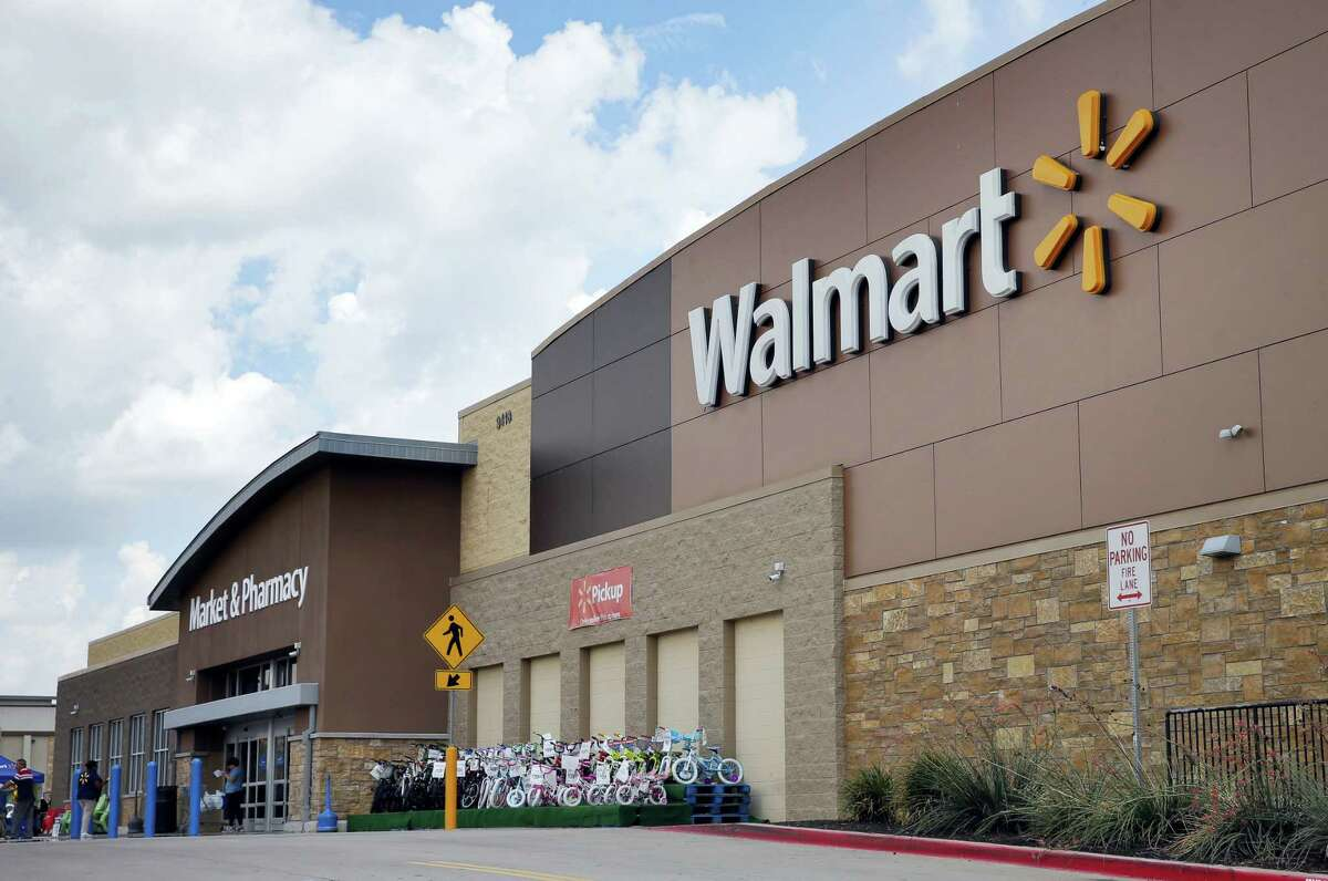 People walk in and out of a Walmart store in Dallas.