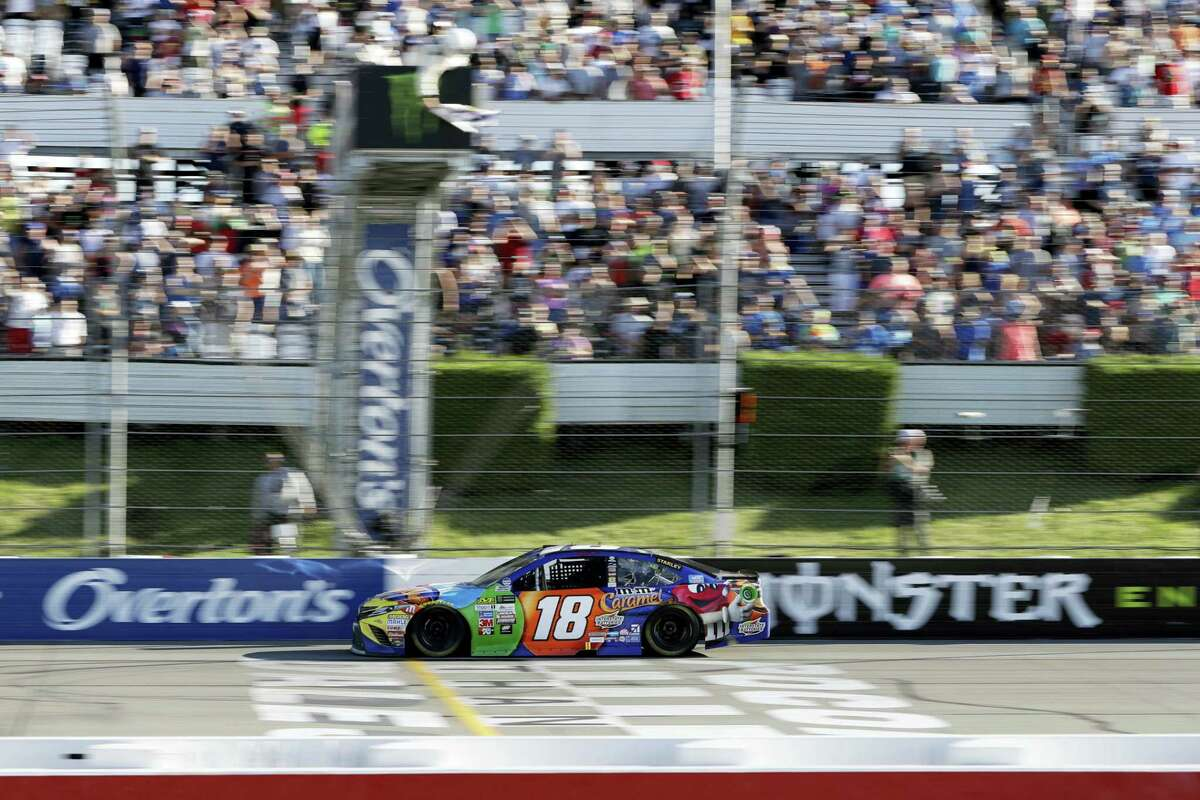Kyle Busch crosses the finish line to win at Pocono Raceway on Sunday.