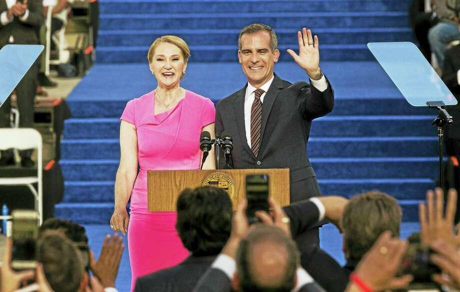 Los Angeles Mayor Eric Garcetti and his wife, Amy Elaine Wakeland. Photo: The Associated Press File Photo  / Damian Dovarganes