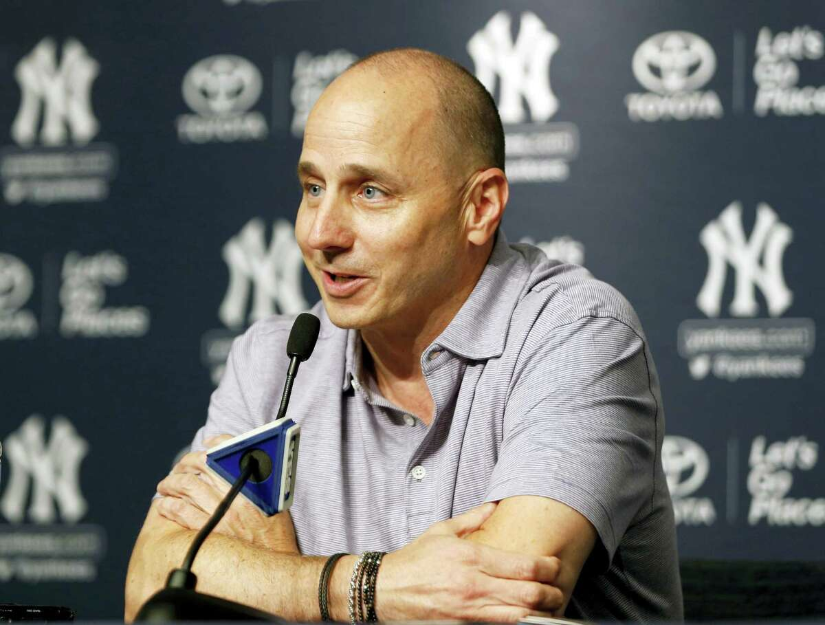 Yankees general manager Brian Cashman speaks to reporters during a news conference on Monday.
