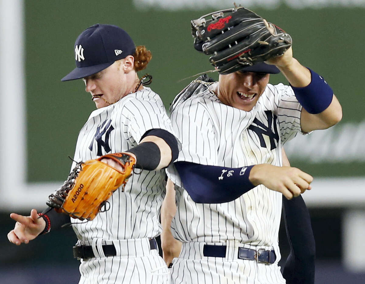 The Yankees' Clint Frazier, left, and Aaron Judge celebrate after the Yankees' win over the Tigers on Monday.