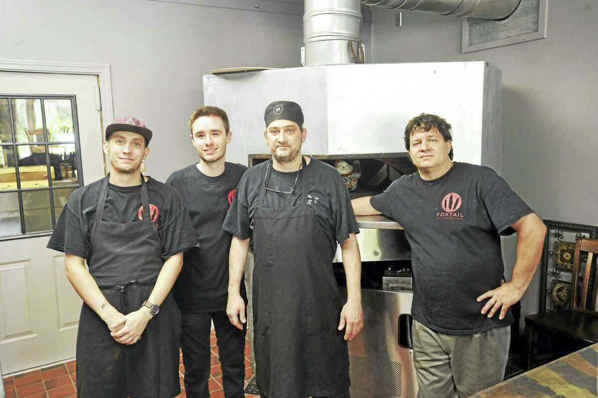 The staff at Foxtail Fine Catering and Cafe, which recently opened in downtown Winsted, includes chef Jay Plourde, second from right, and Armand Lattizori, right.