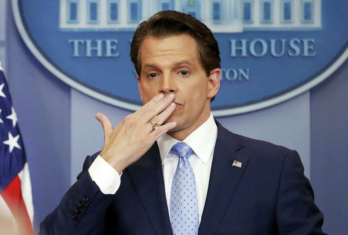 In this photo, incoming White House communications director Anthony Scaramucci, right, blowing a kiss after answering questions during the press briefing in the Brady Press Briefing room of the White House in Washington. Scaramucci is out as White House communications director after just 11 days on the job. A person close to Scaramucci confirmed the staffing change just hours after President Donald Trump's new chief of staff, John Kelly, was sworn into office.