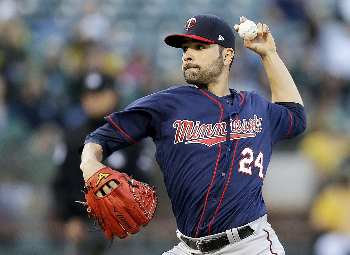 This photo taken July 28, 2017 shows Minnesota Twins pitcher Jaime Garcia working against the Oakland Athletics during the first inning of a baseball game in Oakland, Calif. The Yankees bolstered their rotation a day before the non-waiver trade deadline as they acquired Garcia from the Minnesota Twins for a pair of minor league pitchers.