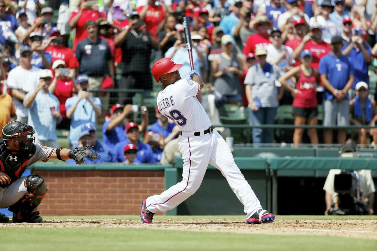 The Rangers' Adrian Beltre follows through on a double for his 3,000th career hit Sunday in Arlington, Texas.