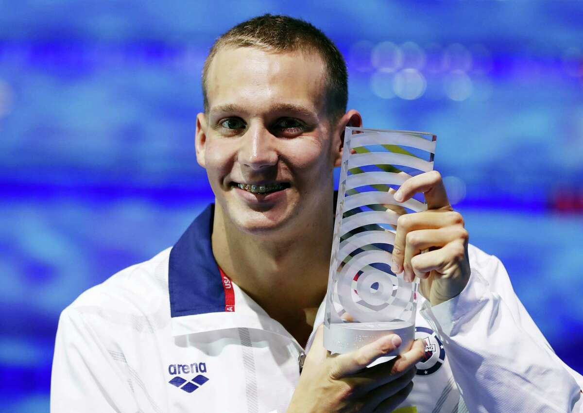 Caeleb Remel Dressel, who won 7 gold medals, shows off the award for best male athlete during the world championships in Budapest, Hungary.