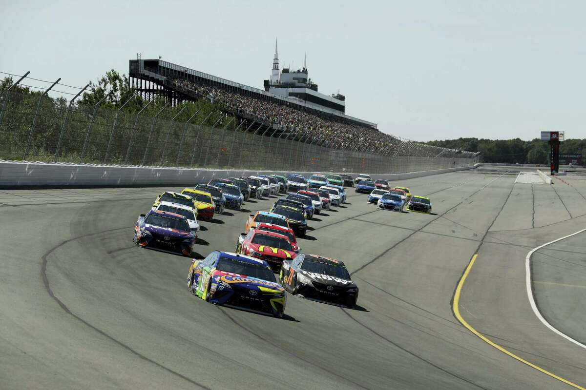 Kyle Busch leads the pack during Sunday's race at Pocono Raceway.