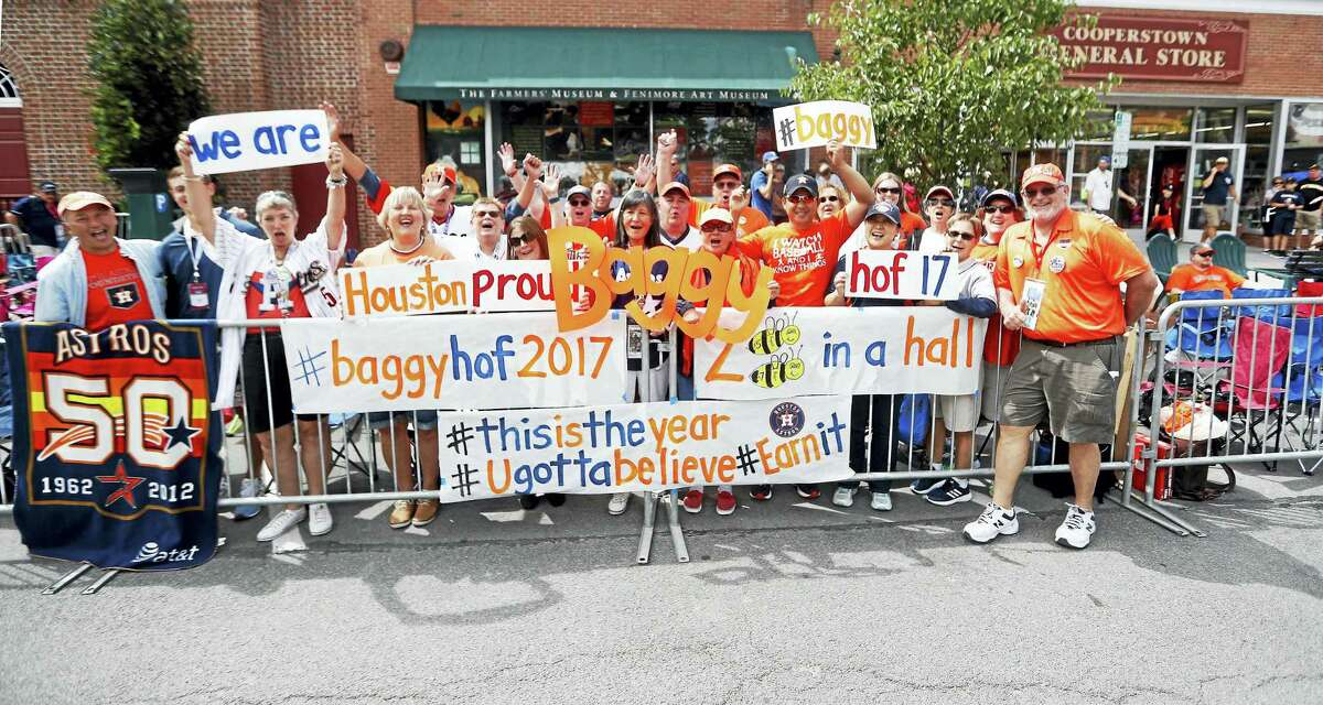 Houston Astros fans outside of the National Baseball Hall of Fame prepare for the Hall of Fame Legends parade up Main Street on Saturday in Cooperstown, New York. Jeff Bagwell will be inducted into the Hall of Fame on Sunday.