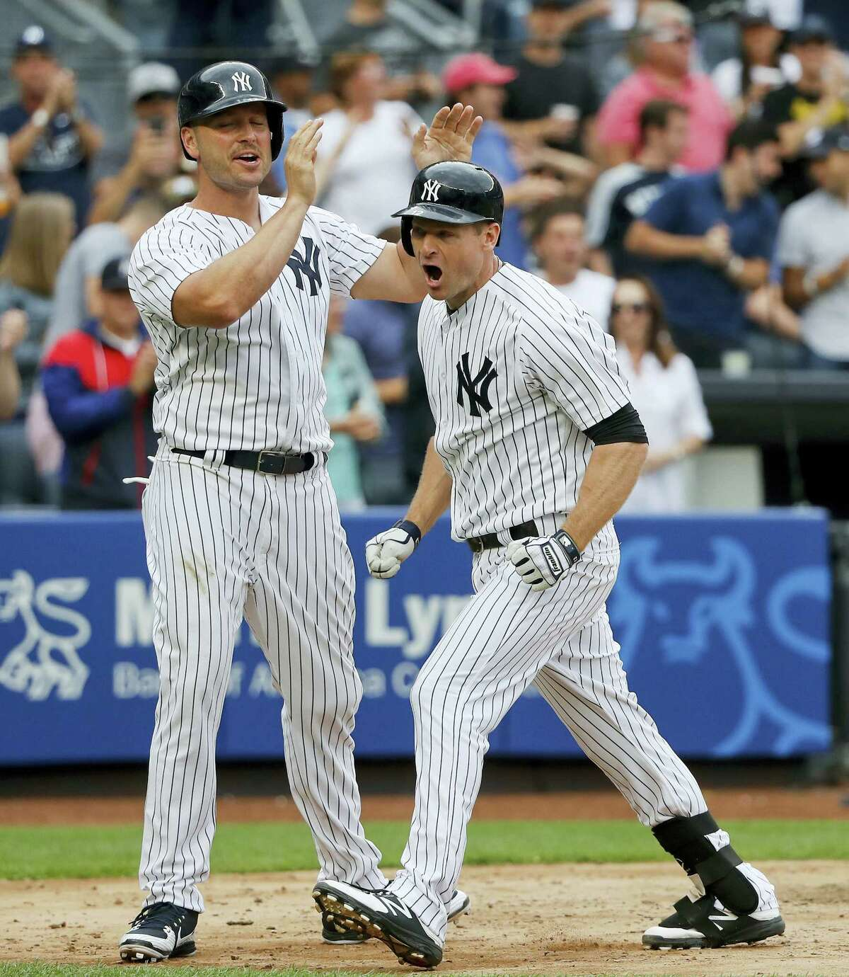 The Yankees' Chase Headley, right, celebrates with Matt Holliday after hitting a two-run home run in the sixth inning.