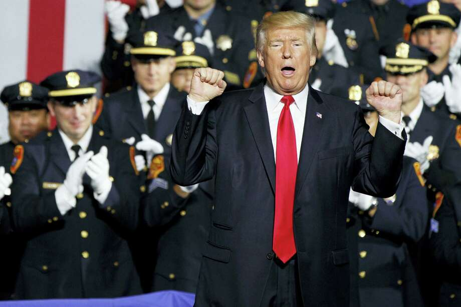 President Donald Trump pumps his fist after speaking to law enforcement officials about the street gang MS-13, Friday, July 28, 2017, in Brentwood, N.Y. Photo: AP Photo/Evan Vucci   / Copyright 2017 The Associated Press. All rights reserved.
