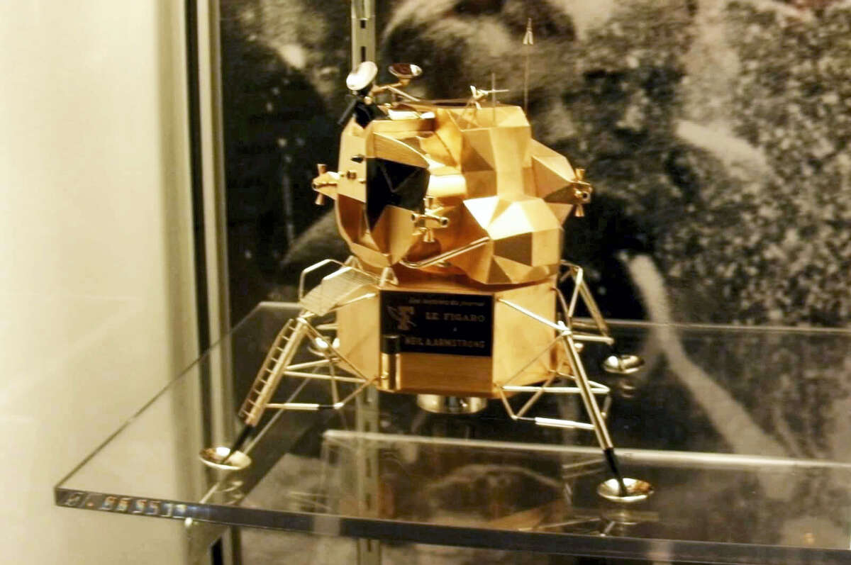 This image provided by Armstrong Air and Space Museum shows a lunar module replica at Armstrong Air and Space Museum in Wapakoneta, Ohio. Police say the rare gold replica of the lunar space module has been stolen from the museum. Police responded to an alarm at the museum just before midnight Friday, July 28, 2017, and discovered the 5-inch high, solid-gold replica had been stolen.
