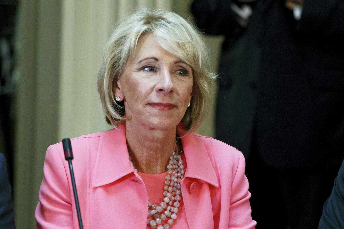 Education Secretary Betsy DeVos is seen in the State Department Library of the Eisenhower Executive Office Building on the White House complex in Washington.