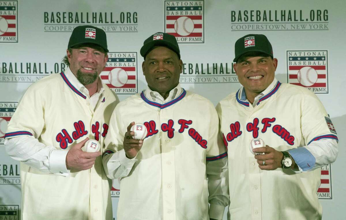 In this file photo, Hall of Fame inductees Jeff Bagwell, left, Tim Raines, center, and Ivan Rodriguez, pose for a photo during a news conference.