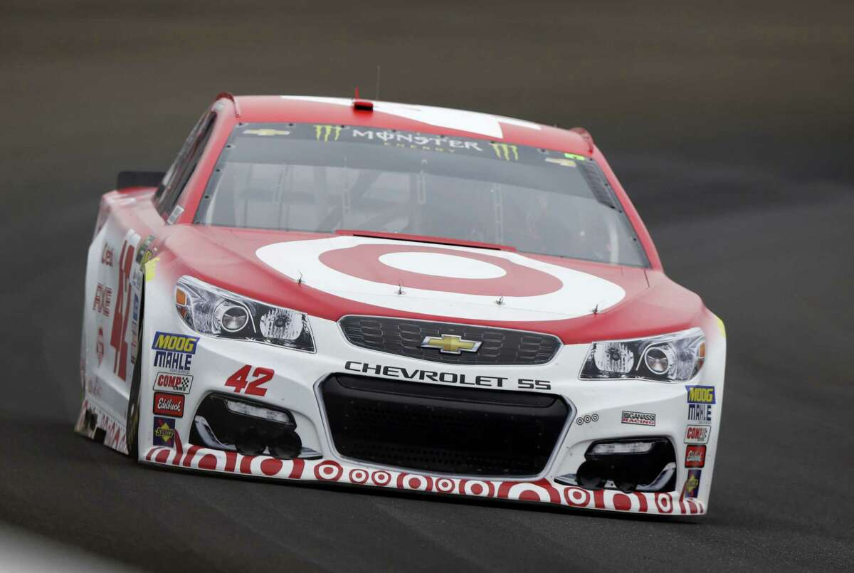 Kyle Larson drives through the first turn at Indianapolis Motor Speedway.