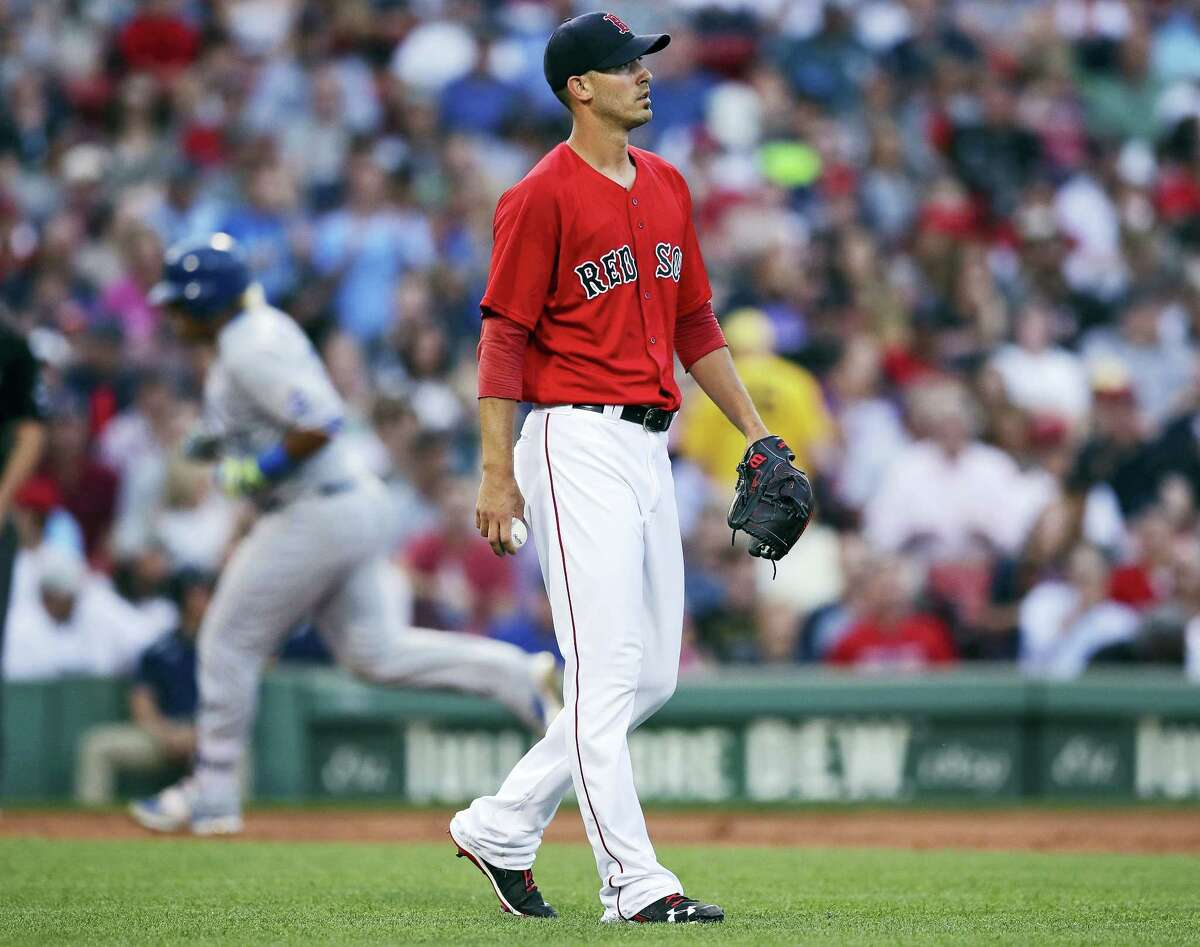 Red Sox starting pitcher Rick Porcello walks away from the mound after a home run by the Royals' Salvador Perez on Friday.