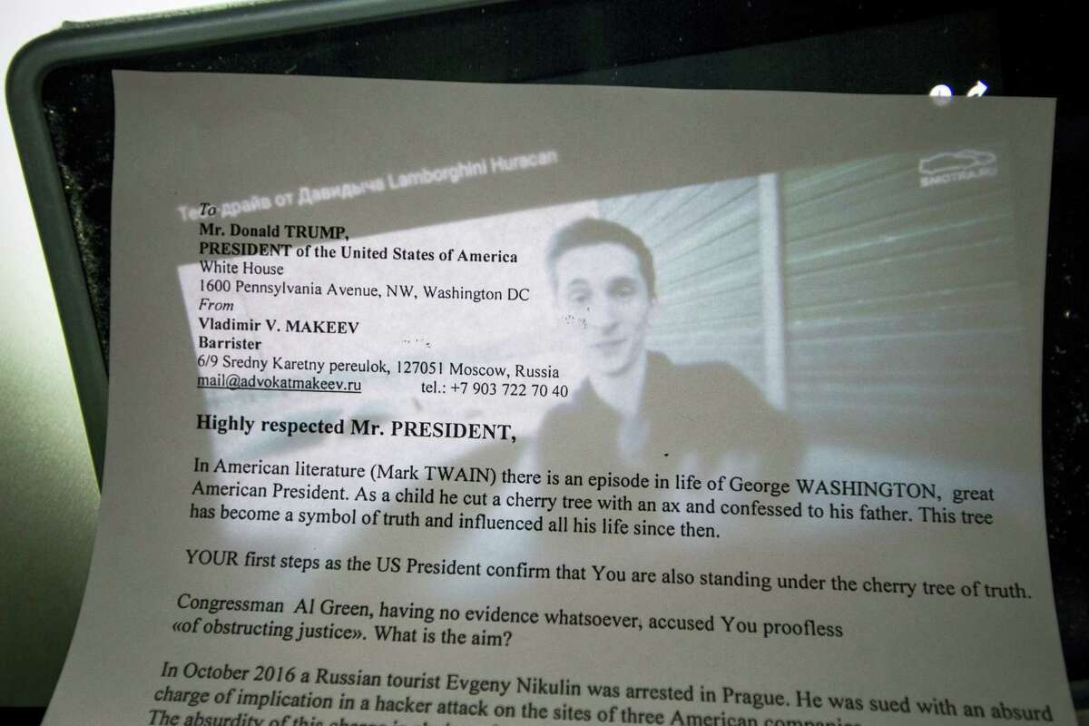 In this Tuesday, July 25, 2017, photo, a copy of the letter written by Russian lawyer Vladimir Makeev to U.S. President Donald Trump lies on a computer screen, showing archive Youtube footage dated Monday, Aug. 2, 2015, featuring suspected hacker Yevgeny Nikulin after a Lamborghini Huracan race outside Moscow, Russia. The U.S. has orchestrated the arrest of five alleged Russian cybercriminals across Europe in the past nine months. The operations come at a fraught moment in relations between Russia and the U.S., where politicians are grappling with the allegation that Kremlin hackers intervened in the 2016 election.