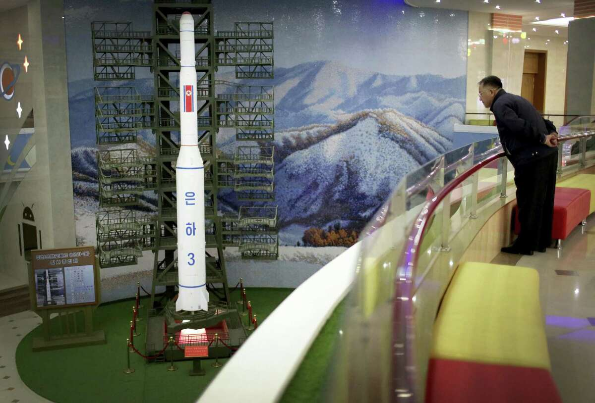 A North Korean man looks at a model of the Unha 3 rocket, a space launch vehicle, displayed at the Mangyongdae Children's Palace on Friday, April 14, 2017, in Pyongyang, North Korea. Amid rising regional tensions, Pyongyang residents have been preparing for North Korea's most important holiday: the 105th birth anniversary of Kim Il Sung's birth, the country's late founder and grandfather of current ruler Kim Jong Un.