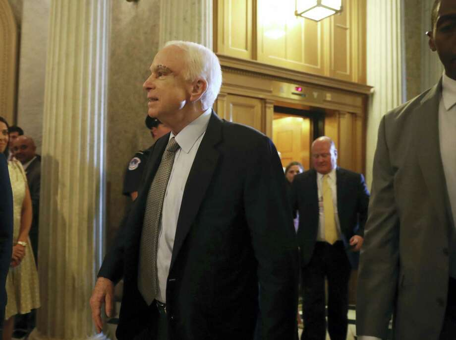 Sen. John McCain, R-Ariz., arrives on Capitol Hill in Washington, Tuesday, July 25, 2017, as the Senate was to vote on moving ahead on health care, with the goal of erasing much of Barack Obama's law. Photo: AP Photo/Andrew Harnik   / Copyright 2017 The Associated Press. All rights reserved.
