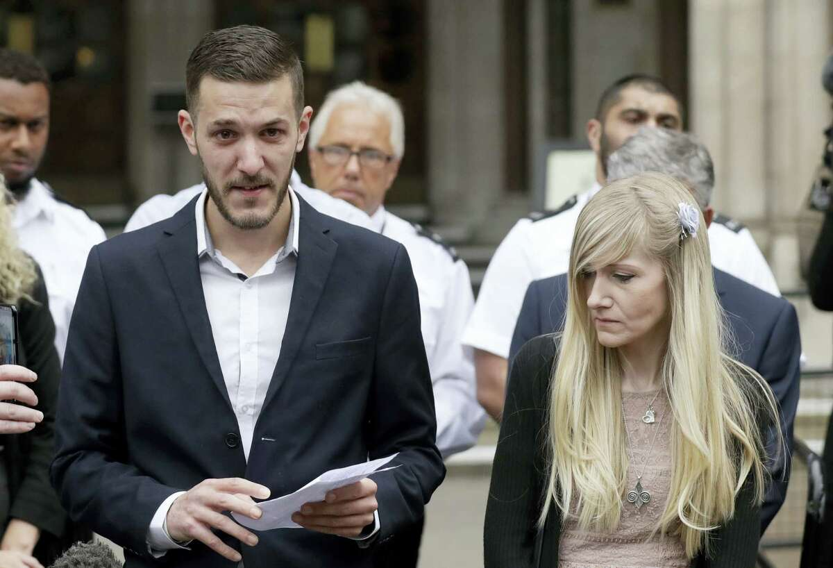 In this file photo dated Monday, July 24, 2017, Chris Gard, the father of critically ill baby Charlie Gard, reads a statement next to mother Connie Yates, right, at the end of their case at the High Court in London. British media are reporting a family announcement that 11-month-old Charlie has died Friday, July 28, 2017.