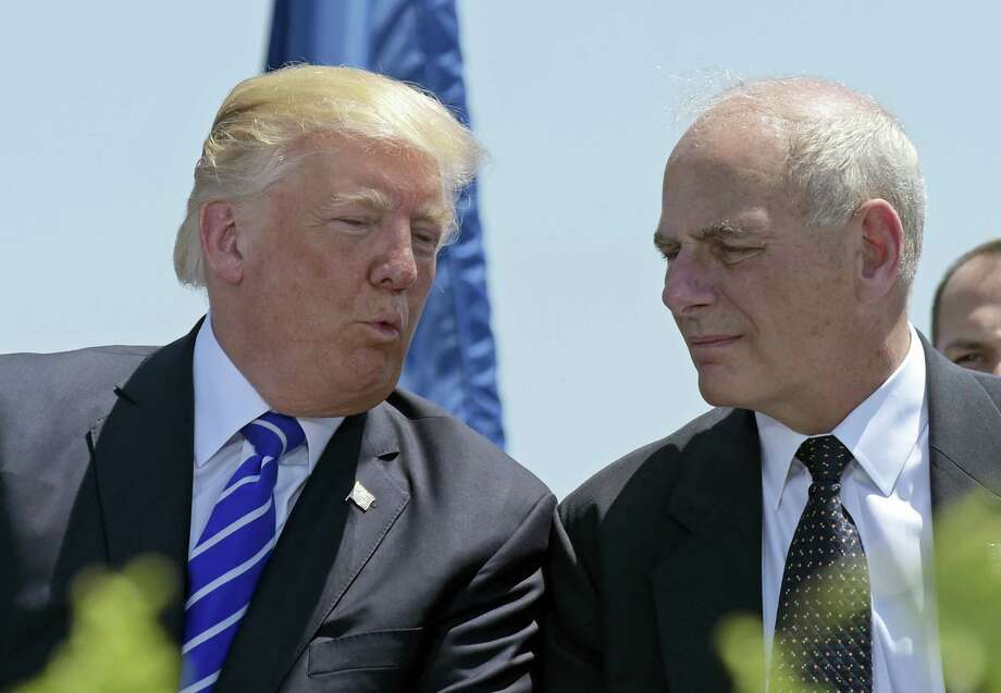 In this May 17, 2017, file photo, President Donald Trump talks with Homeland Security Secretary John Kelly during commencement exercises at the U.S. Coast Guard Academy in New London, Conn. Trump named Kelly as his new Chief of Staff on July 28, ousting Reince Priebus. Photo: Susan Walsh / AP Photo  / Copyright 2017 The Associated Press. All rights reserved.