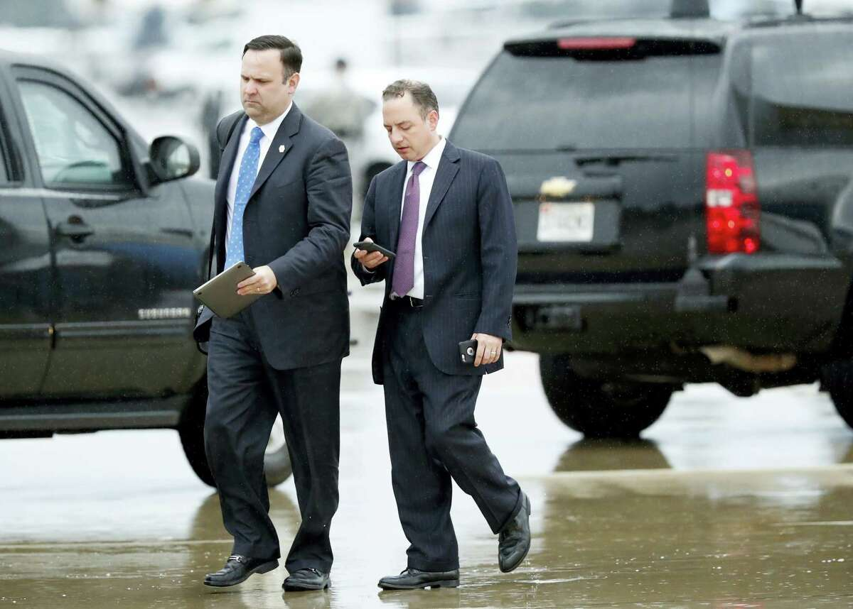 White House Director of Social Media Dan Scavino, left, walks with former White House Chief of Staff Reince Priebus steps off Air Force One as they arrive Friday, July 28, 2017, at Andrews Air Force Base, Md. Trump says Homeland Secretary Secretary John Kelly is his new White House chief of staff.