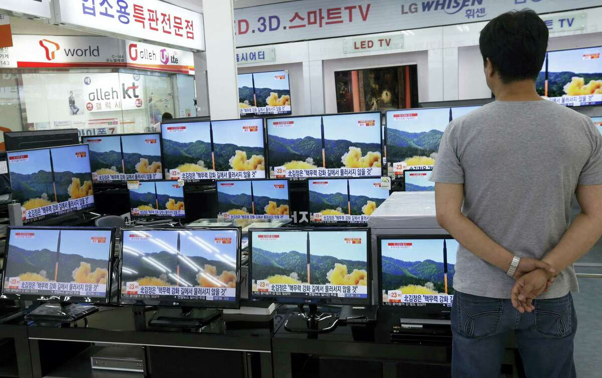 In this July 6, 2017 file photo, a man watches TV screens in an electronics shop showing a news program's report on North Korea's missile firing in Seoul, South Korea. North Korea fired a ballistic missile Friday night, July 28, which landed in the ocean off Japan, Japanese officials said.