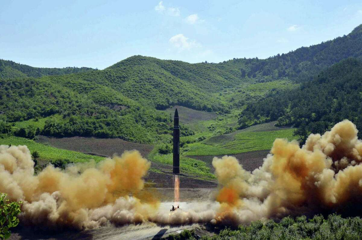 In this July 4, 2017 file photo, distributed by the North Korean government shows what was said to be the launch of a Hwasong-14 intercontinental ballistic missile in North Korea. North Korea fired a ballistic missile Friday night, July 28, which landed in the ocean off Japan, Japanese officials said.
