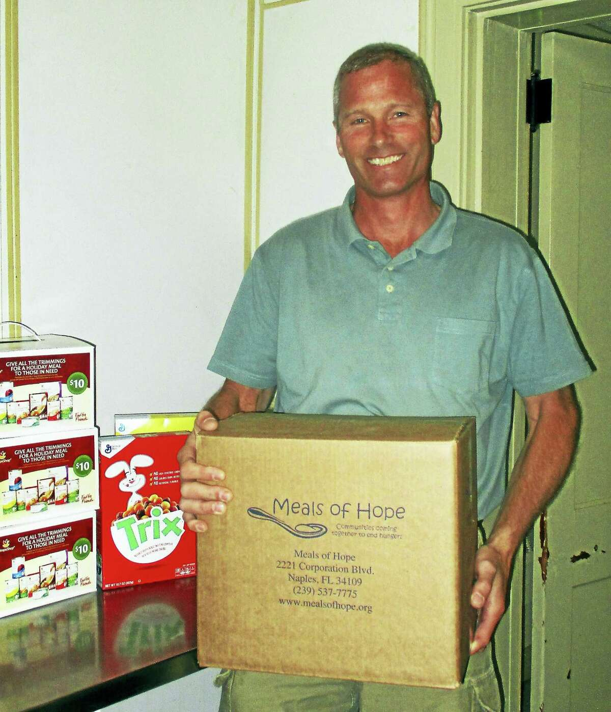 Morris First Selectman Tom Weik, shown helping out at the town's food pantry, is running for a second term in November.