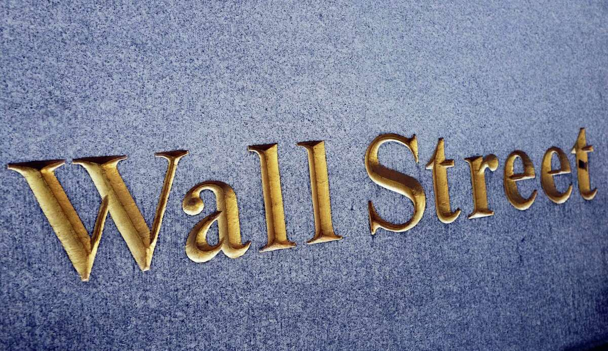 A sign for Wall Street carved into a building located near the New York Stock Exchange.