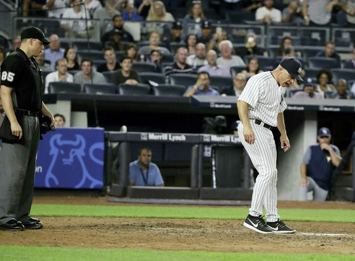 Yankees manager Joe Girardi argues a call with umpire Stu Scheurwater, left, during the seventh inning on Thursday.