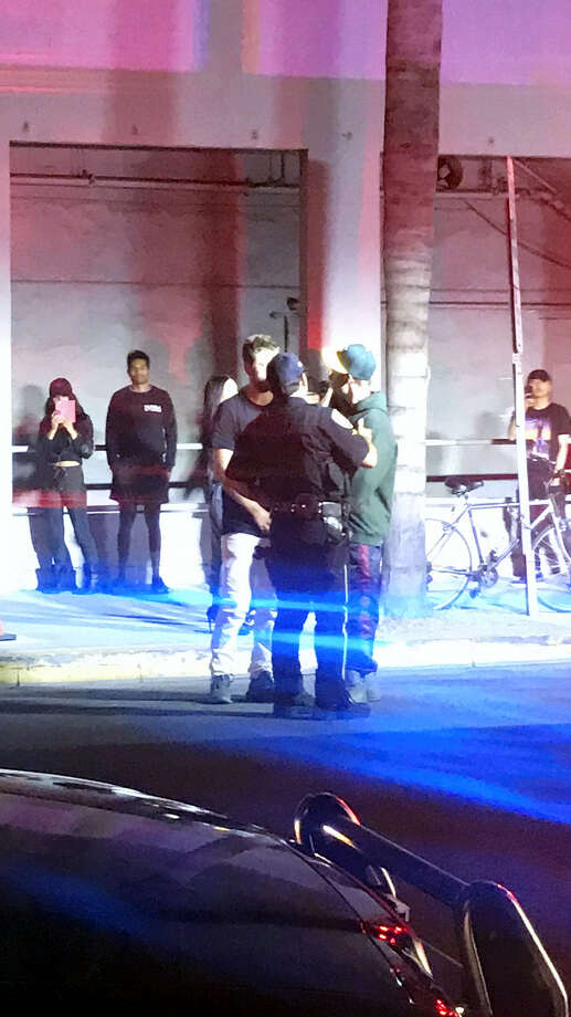 """Popstar Justin Bieber, right, speaks with two people after an incident in Los Angeles Wednesday July 26, 2016. Police say Justin Bieber accidentally struck a photographer with his pickup truck in Beverly Hills. The Los Angeles Times reported that police Sgt. Matthew Stout said the 57-year-old photographer was hospitalized Wednesday night with injuries that were not life-threatening. The newspaper said Bieber """"fully cooperated"""" with officers at the scene. Photo: Alex Hager Via AP   / AP"""